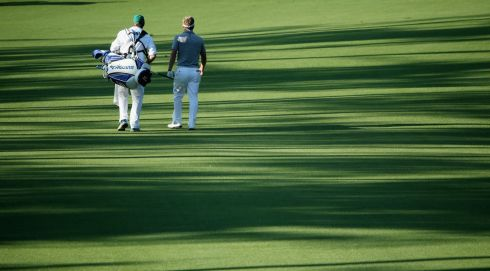 Luke Donald of England and caddie John McLaren on the 18th fairway. Photograph Andrew Redington/Getty Images
