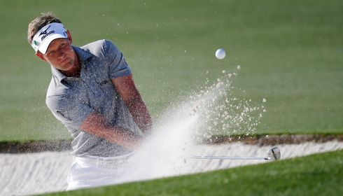 Luke Donald of England hits from a bunker on the 17th. Photograph: Erik S Lesser/EPA