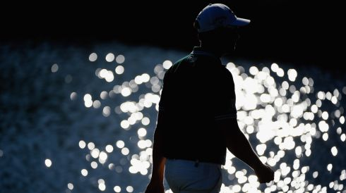 Henrik Stenson of Sweden amid the glare on the 15th. Photograph: Harry How/Getty Images