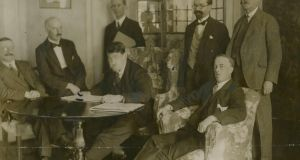 An original monochrome press photograph of the Sinn Féin delegates in  London in 1921 to negotiate the Anglo-Irish Treaty, from left to right: Arthur Griffith, Edmund Duggan, Michael Collins, Robert Barton (at back), Erskine Childers, George Gavin Duffy and John Chartres.  The photograph is estimated at €1,000-€1,500 at Adam's