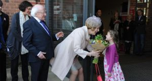 Martha Wainwright (6) presents flowers to  President Michael D. Higgins and his wife Sabina during a visit to the Royal Shakespeare Company in Statford-upon-Avon. Photograph: PA