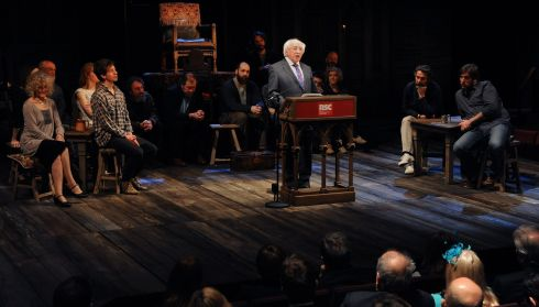 Michael D Higgins gives a speech on stage in front of the cast of Henry IV Part I at the Royal Shakespeare Company. Photograph: Joe Giddens/PA Wire