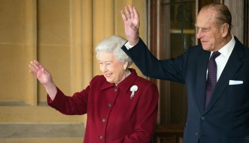 Queen Elizabeth and Prince Philip wave goodbye. Photograph: Leon Neal/WPA Pool/Getty Images