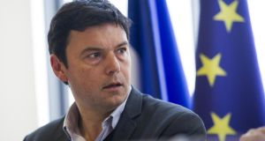 'Thomas Piketty   believes  equality must be promoted politically if democracies are to protect themselves from oligarchical rule.' Photograph: Fred Dufour/AFP/Getty Images