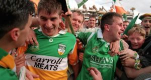 Offaly players and fans celebrate after the dramatic All-Ireland hurling final victory over Limerick in  1994. Photo: James Meehan/Inpho