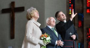 The Very Reverend John Witcombe, Dean of Coventry, showing President Michael D Higgins and his wife Sabina the New Cathedral in Coventry during the final part of the Presidents state visit to Britain. Photograph: Alan Betson/The Irish Times