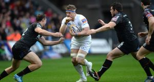 Jamie Heaslip of Leinster is tackled by Aaron Jarvis and Ashley Beck of Ospreys. Photograph: Huw Evans / Inpho