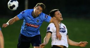UCD's Gareth Matthews and Dundalk's two-goal hero Patrick Hoban clash during the Premier Division match at UCD Bowl, Belfield. Photograph: Inpho