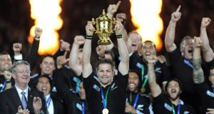Captain Richie McCaw holds aloft the Rugby World Cup trophy.  Photograph: Inpho
