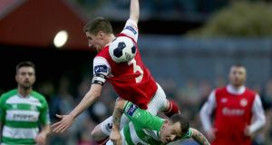 Ian Bermingham of St Patrick's Athletic collides with Shamrock Rovers' Gary McCabe during their Premier League encounter at Richmond Park last night. Photograph: Donall Farmer/Inpho