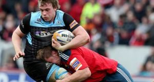 Munster's Dave Foley gets stuck into Jonny Gray of Glasgow Warriors during the first half at Thomond Park. Photograph: Dan Sheridan/Inpho