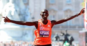 Wilson Kipsang of Kenya celebrates while crossing the finish line  in London. Photograph: Facundo Arrizabalaga / EPA