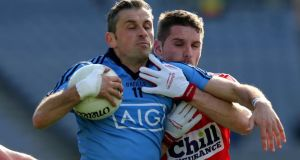 Alan Brogan of Dublin with Daniel Goulding of Cork in Croke Park. Photograph: Donall Farmer / Inpho