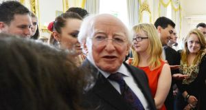 President Michael D Higgins: accompanies by group of key officials and dignatories. Photograph: Alan Betson