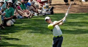 Rory McIlroy  hits out of the rough off of the seventh fairway during the fourth round of the Masters golf tournament  in Augusta, Ga. Photo: Chris Carlson/AP