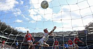 Dublin's Michael Darragh Macauley scores his side's first goal during yesterday's Allianz Football League Division One semi-final at Croke Park. Photograph: Inpho