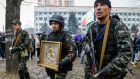 Pro-Russian protesters, one carrying an icon allegedly found in seized state security service office in Luhansk. The icon was given to nearest Orthodox church. Photograph: Reuters/Shamil Zhumatov
