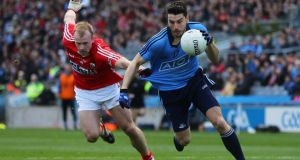 Bernard Brogan of Dublin gets away from  Cork's Michael Shields during the National League semi-final at Croke Park. Photograph: Cathal Noonan/Inpho