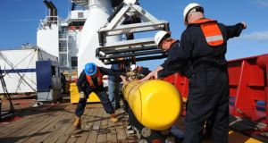 A handout picture made available by the US Navy on 04 April 2014 shows the Artemis autonomous underwater vehicle (AUV) hoisted back on board of the Australian Defense Vessel (ADV) Ocean Shield after a successful buoyancy testing at sea in the Indian Ocean, 01st April 2014. Photograph: Peter D Blair/US Navy/Reuters