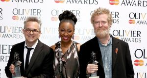 Martin Lowe and Glen Hansard (right) with their Outstanding Achievement in Music award with award presenter Beverley Knight  at the Laurence Olivier Awards at the Royal Opera House   in London. Photograph:  Tim P Whitby/Getty Images