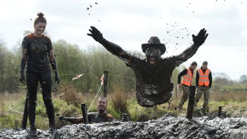 Mud Madness: Competitors came from all over  Ireland, England, Scotland and Germany and the US to compete in the wacky Mud Madness race at Foymore Lodge, Portadown.  Professional athletes, casual joggers and people who are just a bit bonkers made their way across four and half miles of bogs and ponds, under cargo nets, across monkey bars and over inflatable obstacles all in aid of charity partner Marie Curie Cancer Care. Photograph: Charles McQuillan/Pacemaker