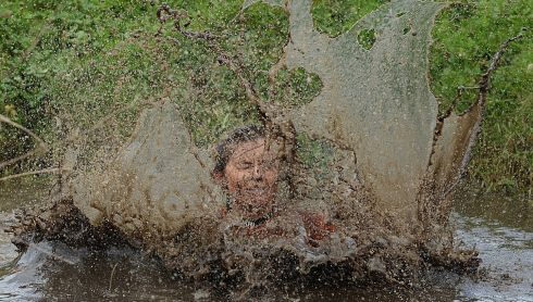 If someone pushed you into that, it would be assault. Jumping in of your own free will is an entirely different mud bath. Photograph: Charles McQuillan/Pacemaker