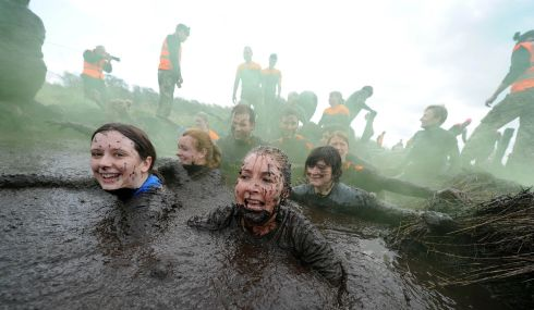 These head-the-balls have all convinced themselves they're having a muddy good time. Photograph: Charles McQuillan/Pacemaker