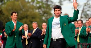 Bubba Watson  poses with the green jacket after winning the 2014 Masters  by a three-stroke margin  at Augusta National.  Photograph:  Rob Carr/Getty Images