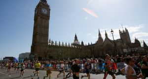 Runners pass the Houses of Parliament during the  London Marathon. Photograph: Harry Engels/Getty Images