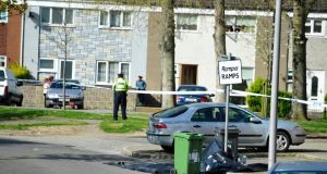 Gardai pictured on Gatweay Avenue in Ballymun, Dublin where a man was shot dead this morning. Photograph: Aidan Crawley
