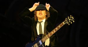 AC/DC guitarist Angus Young on stage at Punchestown.  Photograph: Alan Betson/The Irish Times