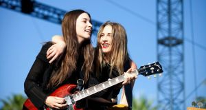 Two of the three HAIM sisters preform at Coachella Photograph: Emily Berl/ New York Times