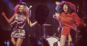 Singer Beyonce (L) performs with her sister Solange. Photograph: Christopher Polk/ Getty Images
