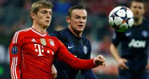 Bayern Munich's Toni Kroos (left) and Manchester United's Wayne Rooney  during their Champions League quarter-final second leg soccer match in Munich. Phnotograph: Kai Pfaffenbach / Reuters