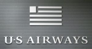 File photograph of US Airways signage. Photograph: Tim Boyle/Getty Images