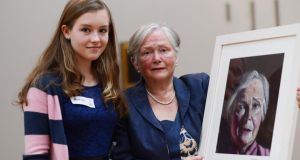 Texaco a rt winner Muirine Robinson from Lacken, Co Wicklow with her grandmother Mary Brennan with the portrait which she won second place in the under1 5 category in the Texaco Art Comeptition.Photograph: Cyril Byrne / THE IRISH TIMES