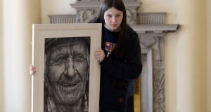 Texaco art winner Shania Mc Donagh left from Claremorris, Co Mayo with her winning portrait at the  Hugh Lane Gallery . Photograph: Cyril Byrne / The Irish Times