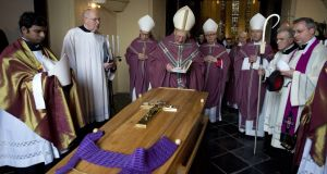 Dutch cardinal Adrianus Simonis (centre) blesses the coffin of former Dutch bishop Jo Gijsen prior to a pontifical mass in the St Christoffel cathedral of Roermond, southern Netherlands, in June 2013. Photograph: Marcel van Hoorn/AFP/Getty Images