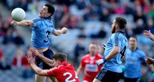 Dublin's Rory O'Carroll battles with Cork's Aidan Walsh at Croke Park last weekend.  Photograph: James Crombie/Inpho