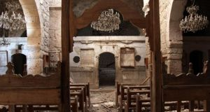 Inside the damaged church of Saints Sergius and Bacchus in Maaloula, north of Damascus. Photograph:  Youssef Badawi/EPA
