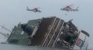 A handout picture  shows rescue helicopters flying over the passenger ship Sewol as it sinks in waters off South Korea's southwestern coast today. The ferry, with 477 people on board, was reported sinking off the south-western coast of South Korea while en route from the port of Incheon, west of Seoul, to Jeju Island. The passengers were mostly secondary school students on a field trip to Jeju Island. The Coast Guard dispatched patrol boats and aircraft for rescue operations. Photograph: Yonhap/EPA