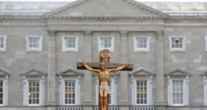A crucifix stands outside  Leinster House in  Dublin. Photograph: Gareth Chaney/Collins