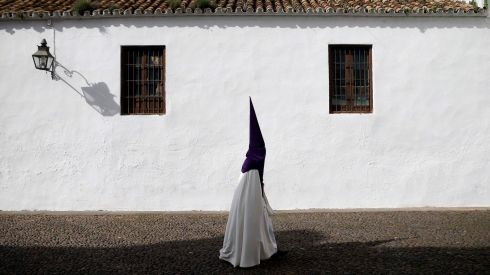A penitent walking to join the procession of La Sangre brotherhood in Cordoba, southern Spain yesterday. Photograph: Javier Barbancho/ Reuters