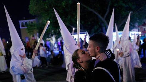 A couple embrace next to the San Gonzalo procession in the Andalusian capital of Seville. Photograph: Marcelo del Pozo/Reuters
