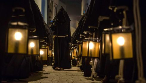 Penitents of the El Perdon (Forgiveness) brotherhood hold lights during the procession in Almeria, southeast Spain. Photograph: Francisco Bonilla/Reuters