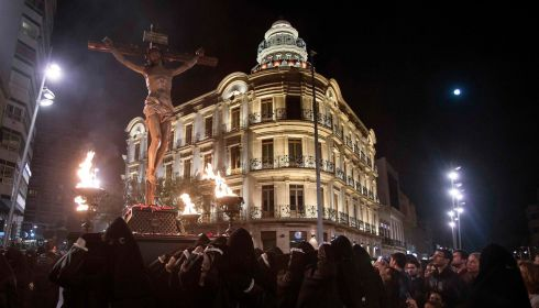Crowds gather to watch as penitents in Almeria  carry an image of the El Perdon (Forgiveness) Christ yesterday. Photograph: Francisco Bonilla/Reuters