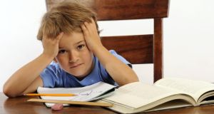 Sit down with your son and plan the ideal homework routine with him. Photograph: Getty Images