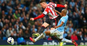 Connor Wickham of Sunderland scores his  second under pressure from Fernandinho of Manchester City at Etihad Stadium. Photograph:  Alex Livesey/Getty Images