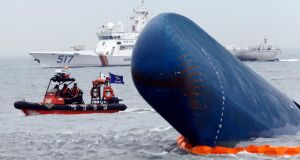 Rescue boats sail around the South Korean passenger ship Sewol which sank, during their rescue operation in the sea off Jindo. Photograph: Kim Kyung-Hoon/Reuters