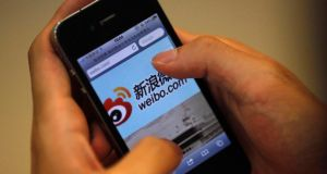 A man visits Sina's Weibo microblogging site. Photograph: Carlos Barria/Files/Reuters